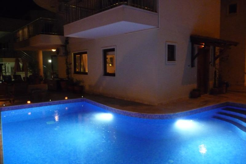 The beautifully illuminated pool wraps right round the Pearl, from the front door to the back
