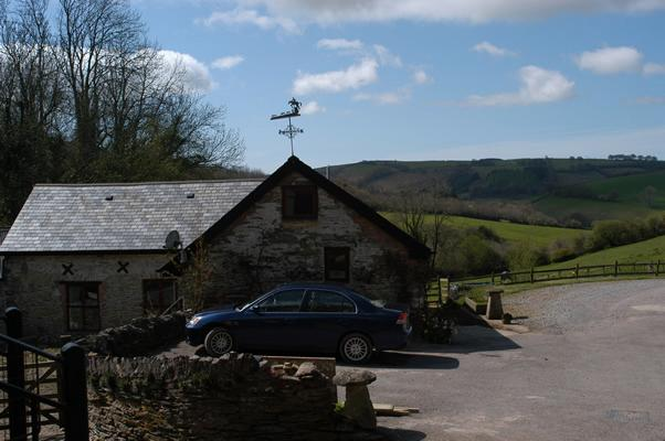 Farthingwood barn and its outlook