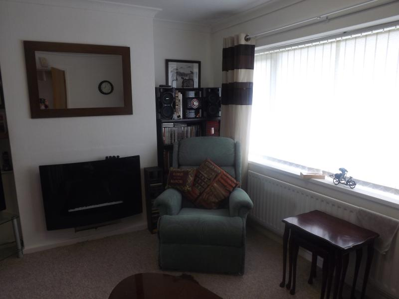 Living area with 2 seater sofa and reclining chair
