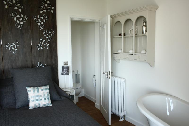 Luxurious first floor bedroom with sea views from the slipper bath