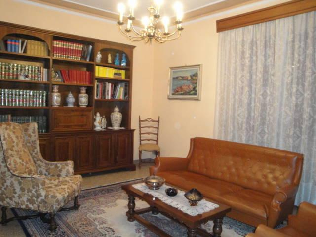 living room with library and sofas