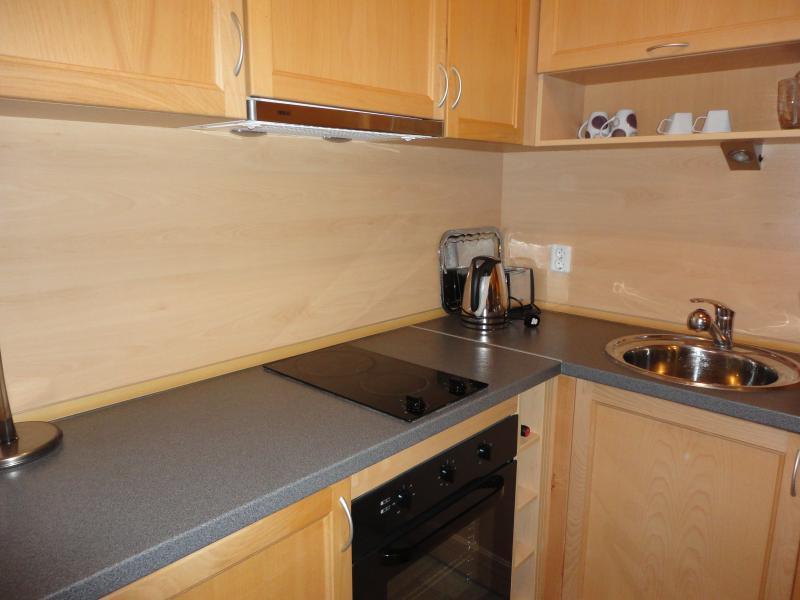 Fully equipped modern kitchen including oven, hob, dishwasher, fridge/freezer, microwave, toaster.