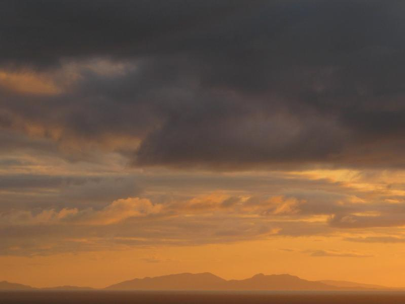 The sun setting behind the Outer Hebrides creates unforgettable memories from Island View!