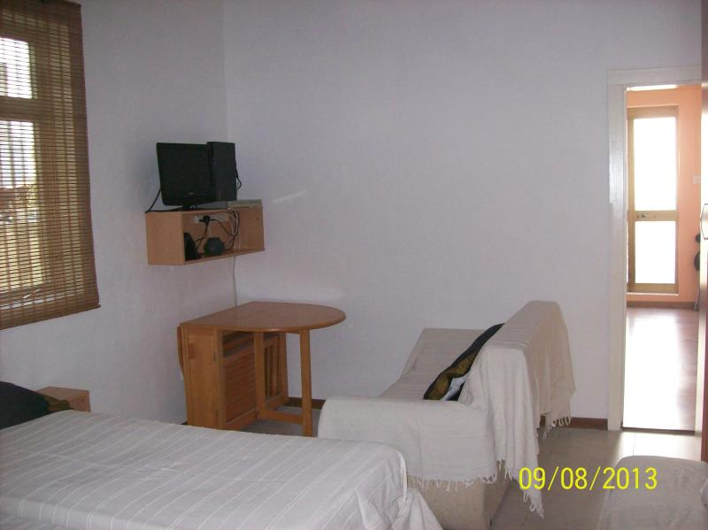 bed- living room/ a double bed+2 sofas/colapsable table for 4/TV/DVD/ sheets and linen provided