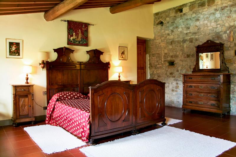 Large twin room with two sets of windows and views over the pool and countryside