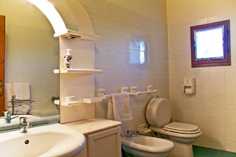 Large bathroom with shower over bath, basin w/vanity unit , w.c. and bidet