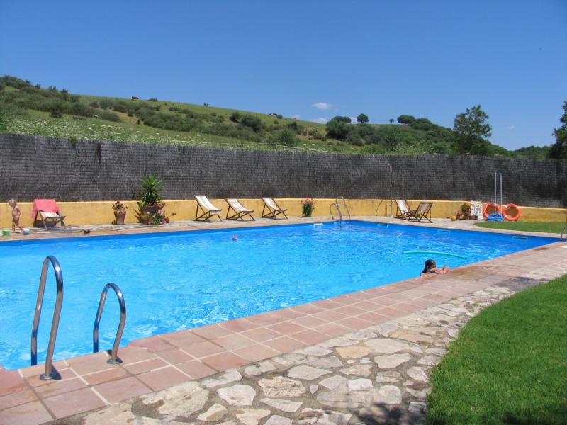 Beautiful large pool at the Cortijo Roman with stunning views of the village of Jimena
