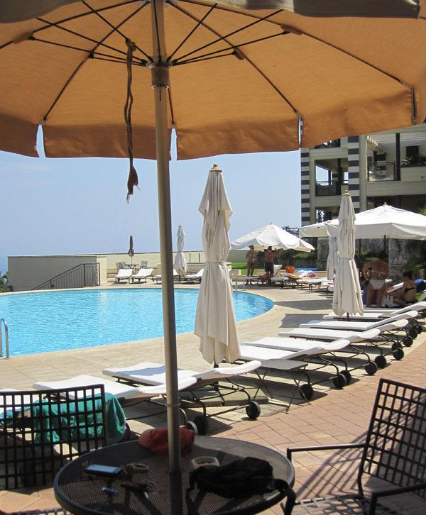 The shared swimming-pool has umbrellas and sunbeds and lifiguard service (summer time)