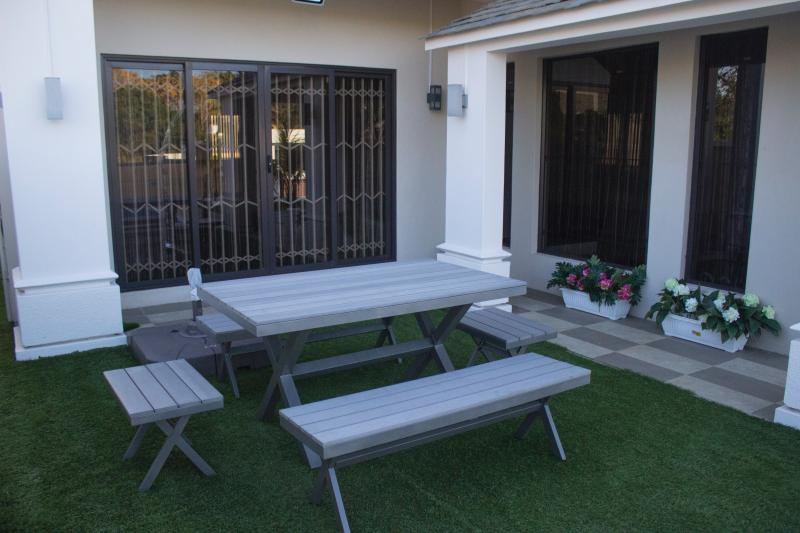 Garden with outdoor dinning table.