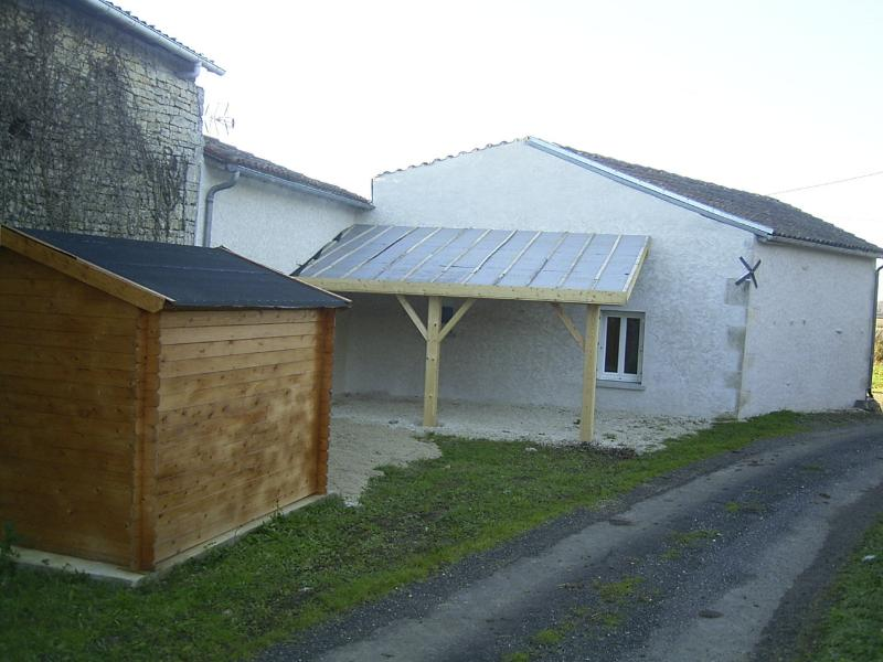 Rear of property with car port
