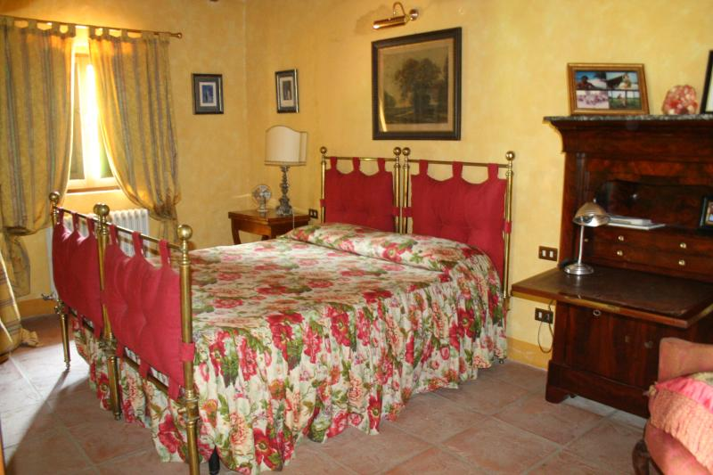 The welcoming bedroom, furnished with antiques
