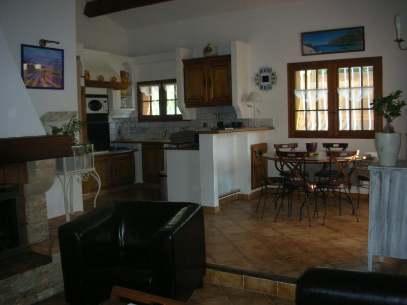 kitchen dining living room with fireplace, air conditioning and heat pump