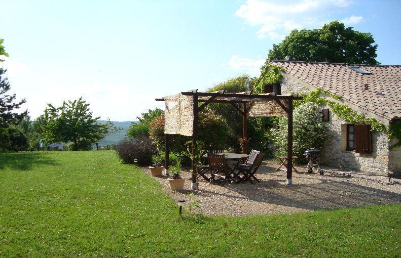 Les Lavandes terrace abd view down the garden