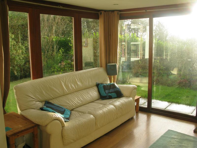 Conservatory Lounge with sofa, large TV, wii, blueray player