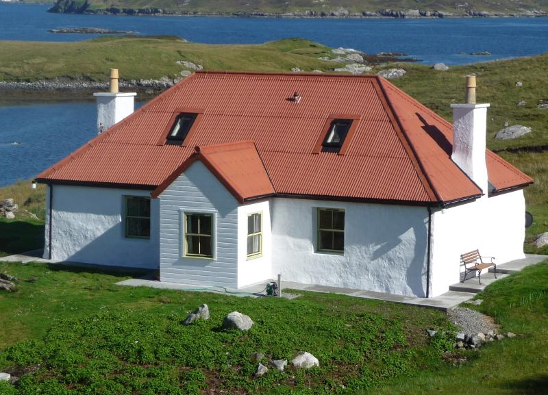 A peaceful haven Red House or Tigh Dearg with its iconic red roof  renovated from an old blackhouse.