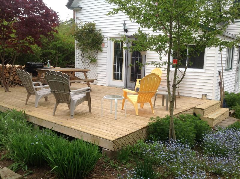 Large new furnished deck is a very private sheltered sun spot all day long, completed with BBQ.
