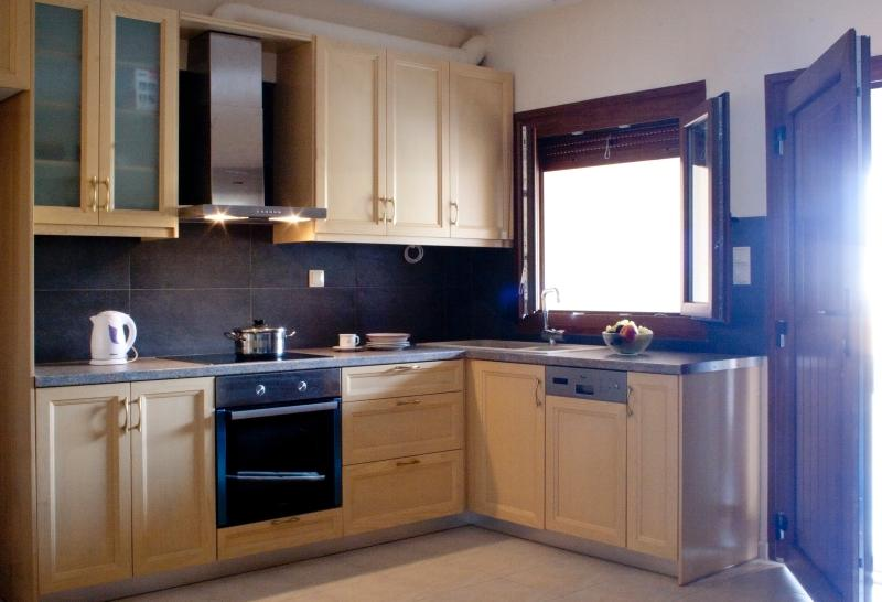Kitchen. Family size appliances. Air-con and leading to veranda