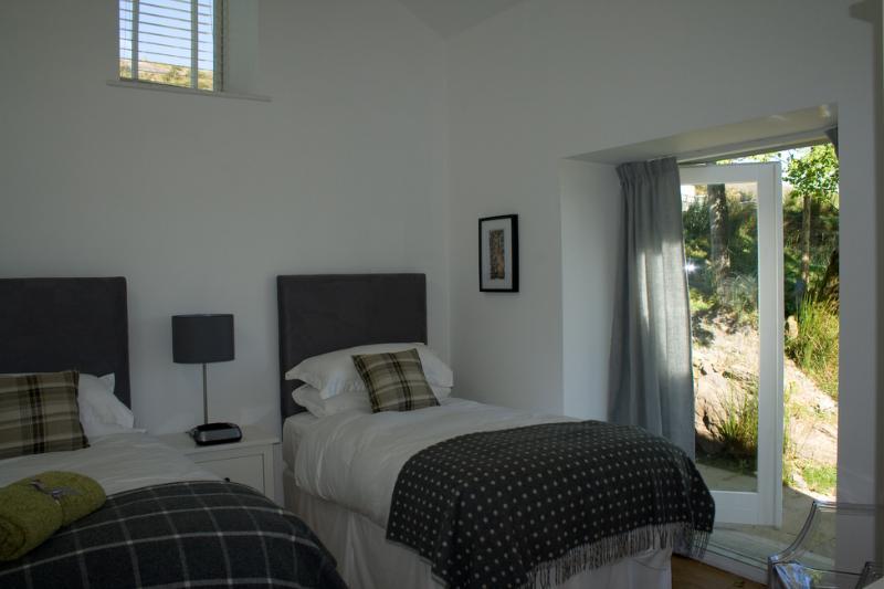 Dormitorio 3 configura con dos camas individuales de lujo.