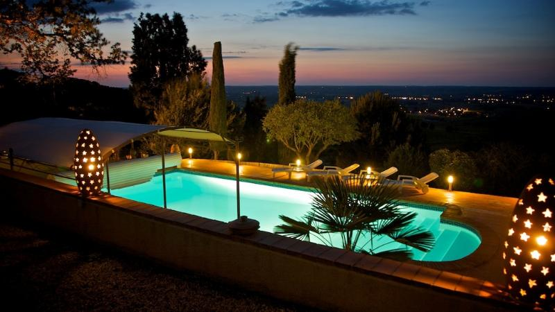 Night-time swimming in heated pool