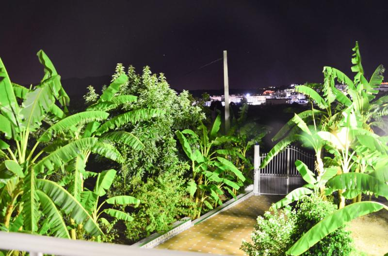 Views from bedroom balcony at night. City center at the end