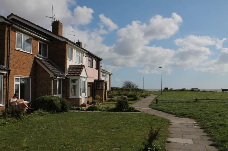Peaceful setting - footpath in front of the house and views of the sea across the green