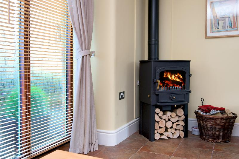 The woodburning stove provides the focal point for cosy winter evenings.