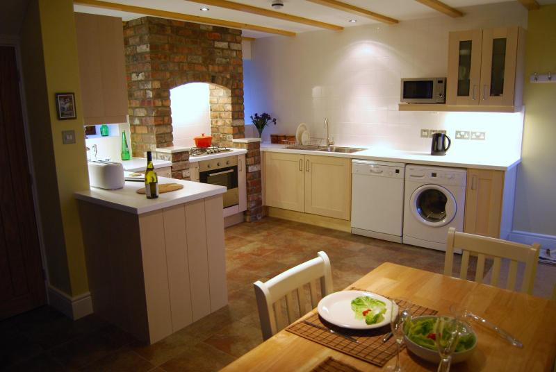 The kitchen area is exceptionally light and airy, well equipped and a dream to use.