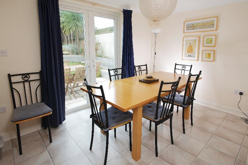 Separate dining room overlooking the sunny garden with patio doors