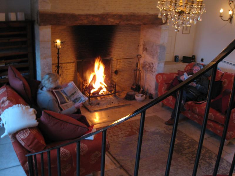 The sitting room with the Christmas log fire