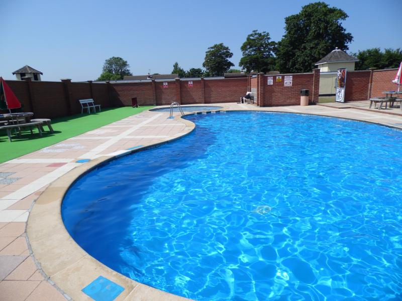 The beautiful outdoor heated pool, with childrens pool at the end, open from May till September