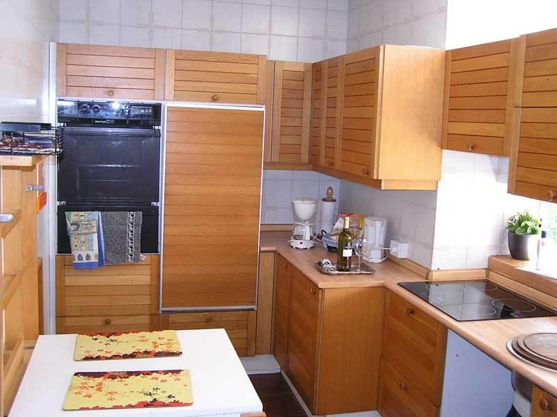 Fully fitted kitchen with electric hob, oven etc