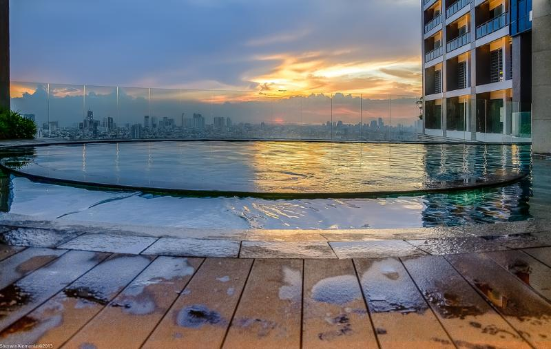 Infinity pool with sunset view located half way up the tower