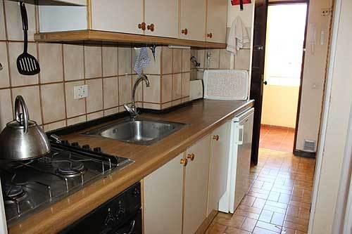 Galley kitchen, front door