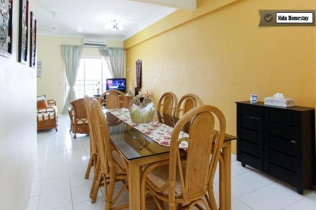 Spacious living hall with sofa, dining table, 32' LCD TV, ASTRO, aircond and balcony with view.