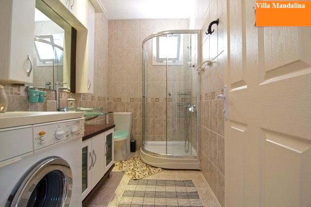 Bathroom with shower and wasching machine