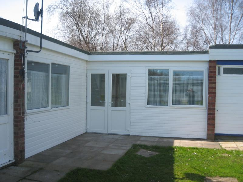 The outside of the chalet with double doors for disabled access