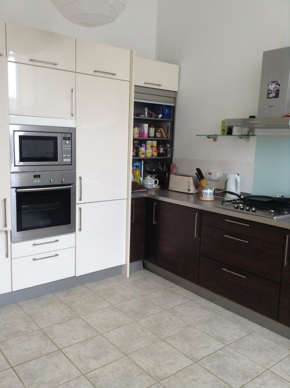View of the dining kitchen showing oven, fridge freezer and gas hob