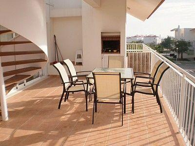 Terrace with BBQ and spiral staircase leading to roof terrace