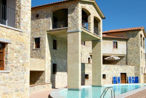 Half-moon pool and sunbathing area