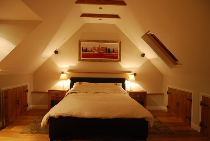 King sized bed in spacious living area with central heating