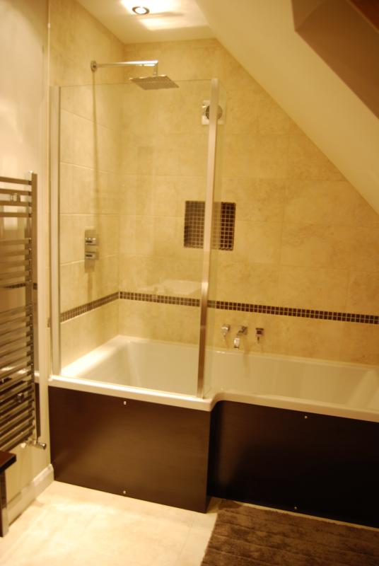 Ensuite bathroom with bath, shower and under floor heating