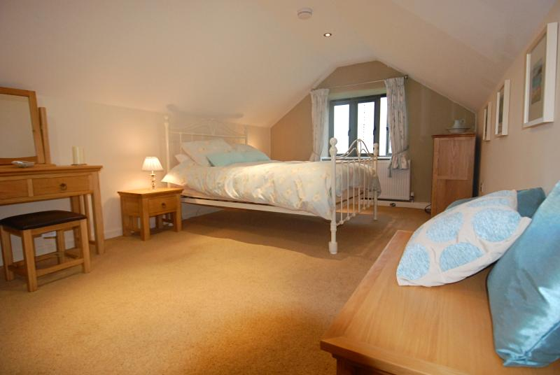 Master bedroom in the eaves with far reaching valley views (ample headroom; 8ft )