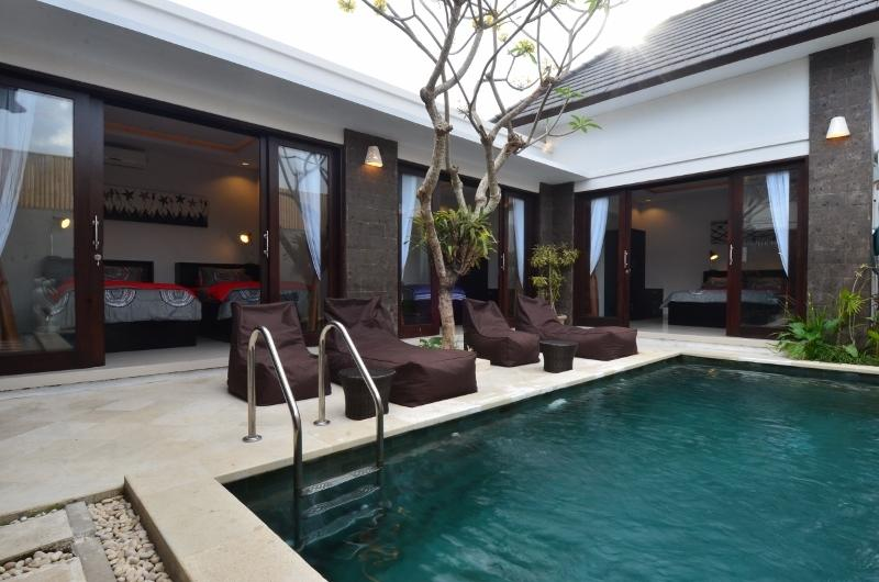 Private Pool - Sunbathe by day in comfortable lounges