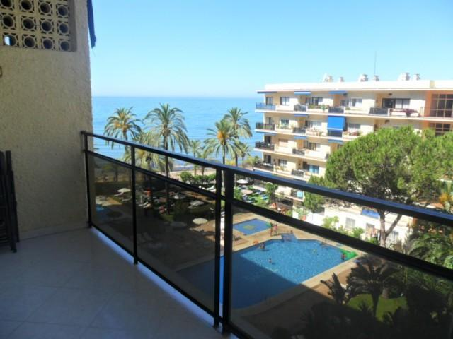 View from the balcony over the swimming pool and sea