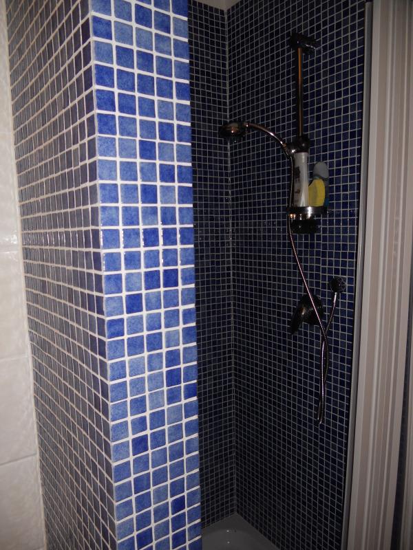 La cabina de ducha.