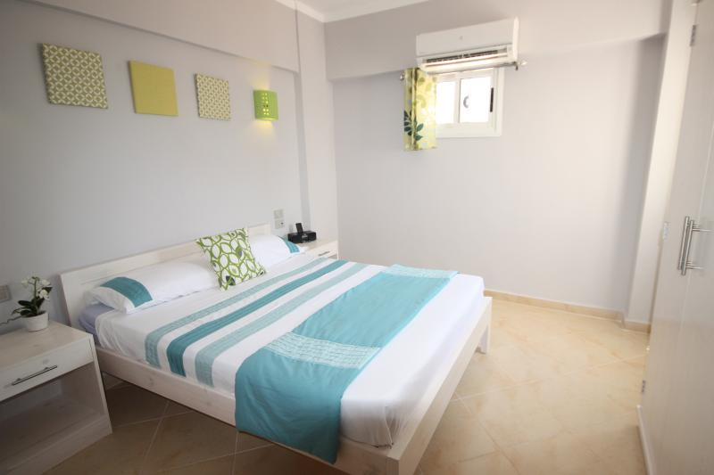 Master bedroom (150cm double bed). The second bedroom has twin beds. Both have wardrobes.