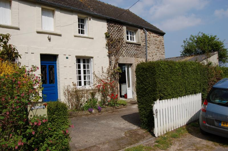 The house from the front - blue door to sitting room and white door to kitchen