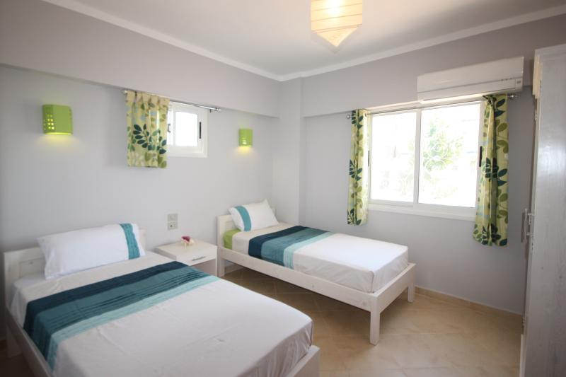 Twin bedroom (100cm wide beds), with a good size wardrobe.