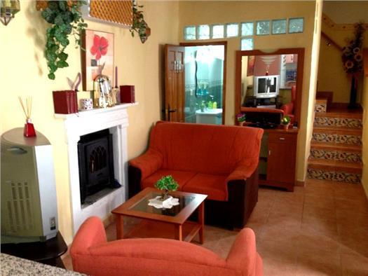 Authentic Andalusian living room with fireplace