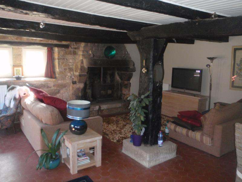 The homely and cosy living room with log burner and dining table